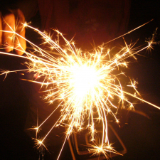 A picture of a person holding a lit sparkler